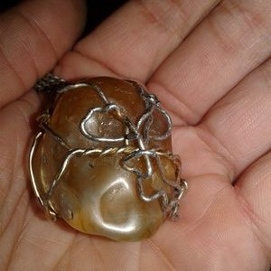 skull shaped Amber wrapped in stainless steal